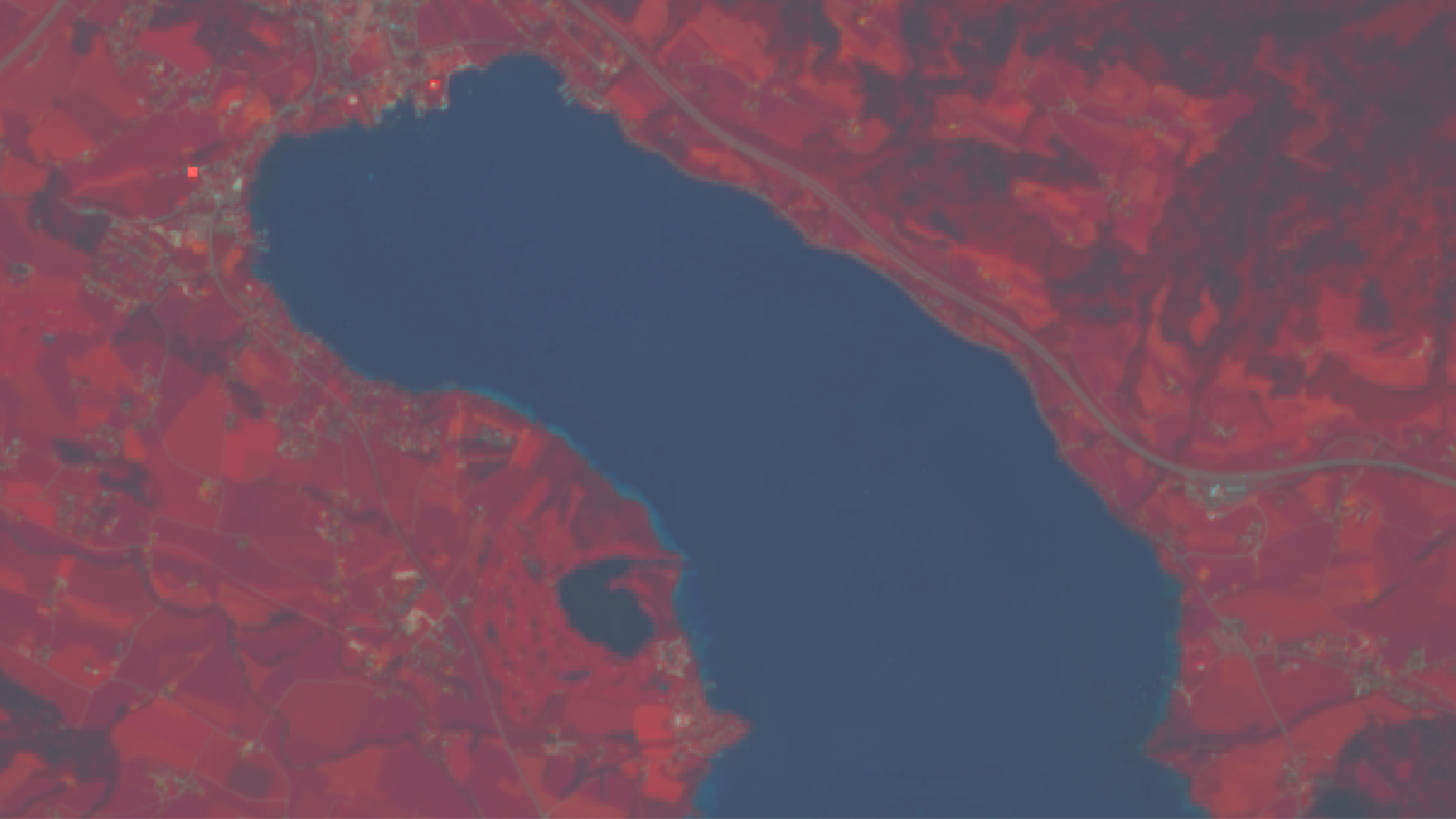 Sentinel-2 false-colour image of Lake Mondsee in Austria. The lake appears deep blue whereas the surrounding vegetated areas are coloured red due to the strong reflection of sunlight in the infra-red portion of the electro-magnetic spectrum